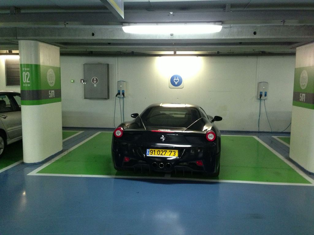 Double parked in electric car charging area – douchebag level 9000+